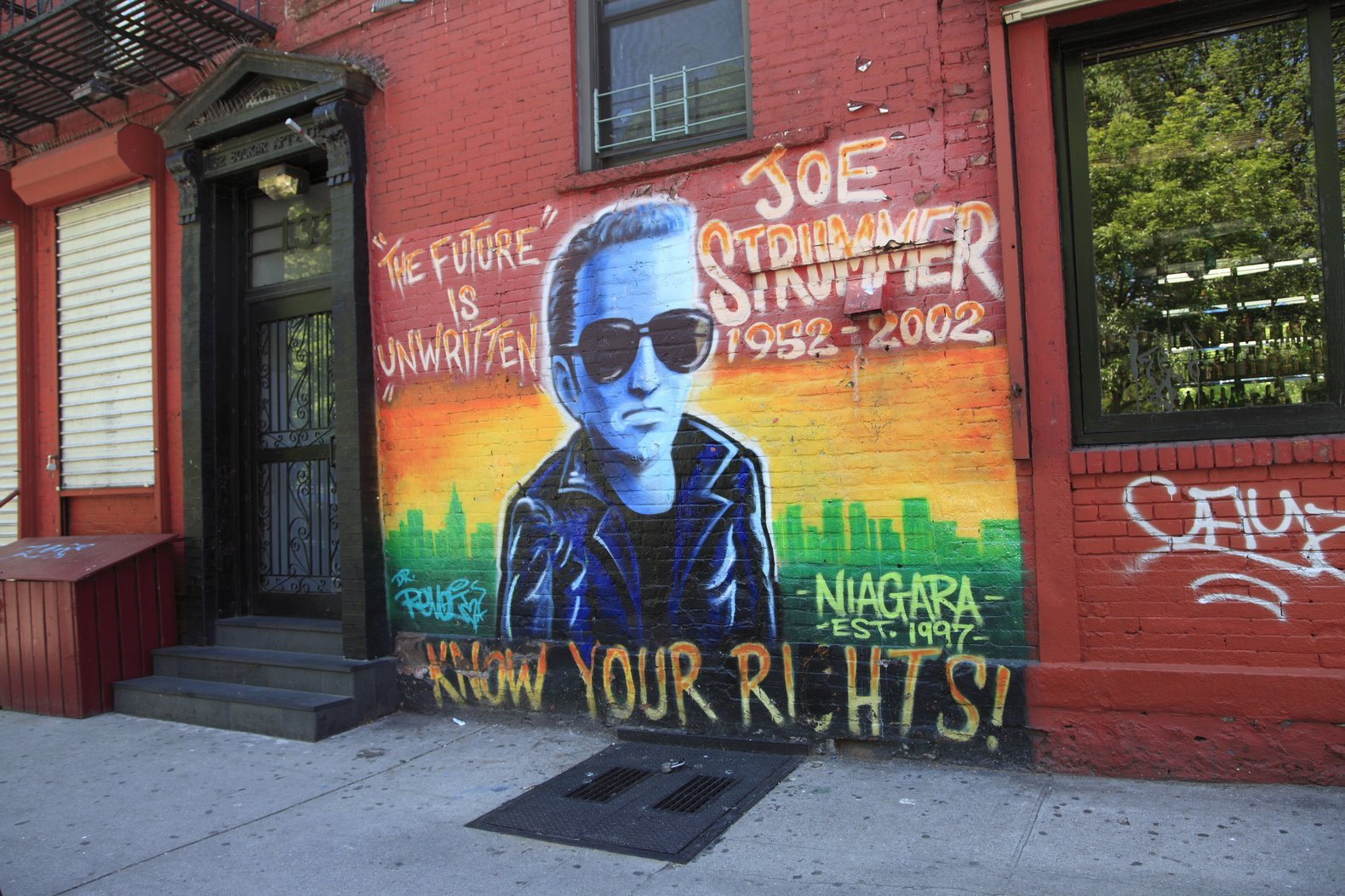 Memorial mural for Joe Strummer of The Clash on the wall of the Niagara Bar, East Village, Manhattan, New York City